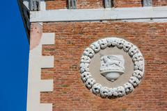 Architectural detail of Tower at the entrace of the Arsenale Stock Photos