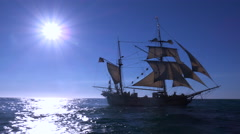 A tall masted clipper ship sails on the high seas against the sun. Stock Footage