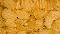 4k – Potato chips on wooden board 02 - stock footage