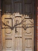 Old wooden door of unpainted wood closeup - stock photo