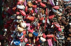 Trees with locks of lovers on  trees at Bolotnaya waterfront - stock photo