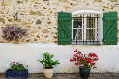 Windows with wrought iron bars Grimaud Var Provence Alpes Cote dAzur region Stock Photos