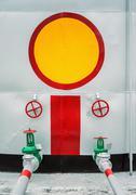 Gate valves at the storage tank - stock photo