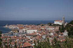 Stock Photo of Cityscape with lighthouse and Cathedral of St George Piran Istria Slovenian
