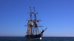 A tall masted clipper ship sails on the high seas. - stock footage