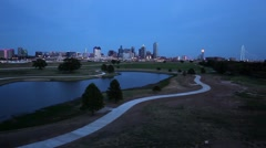 Dallas skyline wide shot at dusk with Trinity Park in foreground Stock Footage