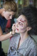 Actress being painted by makeup artist as a zombie for the zombie comedy Brain Kuvituskuvat