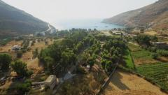 Fly over the summer valley to the beach, aerial footage Cyclades islands Greece Stock Footage