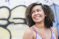 Stock Photo of Portrait of smiling young woman with curly hair