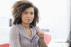 Stock Photo of Young woman working at office