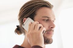 Stock Photo of Mid-adult man talking on phone