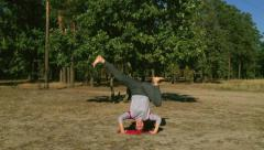 Funny exercise. Yoga in the head. Stock Footage