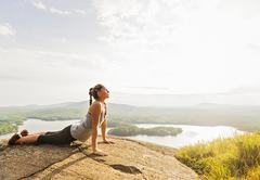Stock Photo of Young woman exercising outdoor