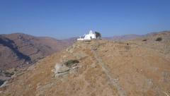 Drone flying uphill to small perfect wedding spot Cyclades summer island Greece Stock Footage