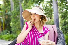 Stock Photo of Woman eating snacks