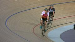 Cycling enthusiasts circle London's Olympic Velodrome Stock Footage