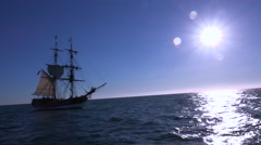 A tall masted clipper ship sails on the high seas. Stock Footage