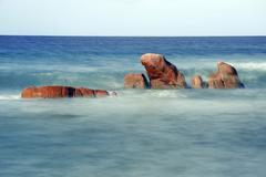 Granite rocks Anse Takamaka beach Praslin Island Seychelles Africa - stock photo