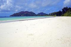The kilometerlong beach Anse Volbert Praslin Island Seychelles Africa - stock photo