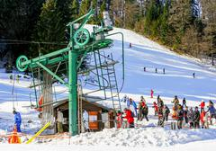 GERARDMER, FRANCE - FEB 19 - Group of skiers standing in line in front of ski Stock Photos
