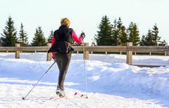 GERARDMER, FRANCE - FEB 20 - Portrait of mature woman skiing outside on Feb 1 - stock photo