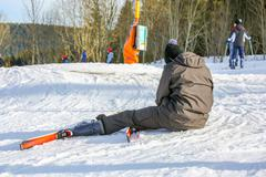 GERARDMER, FRANCE - FEB 16- Beginner skier fell to the ground during the annu - stock photo