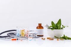 Herbal medicine VS Chemical medicine the alternative healthy care with stetho - stock photo