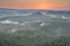 Stock Photo of Mist rising from the forest in the morning at sunrise Saxon Switzerland Elbe