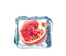 pomegranate in the ice cube - stock illustration