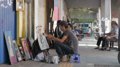 Street artists painting in Batavia,Jakarta,Java,Indonesia - stock footage