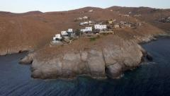 Rocky coast summer villas in Greece, aerial footage from Cyclades summer island Stock Footage