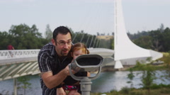 Father and daughter looking through viewer at Sundial Bridge: Redding, - stock footage