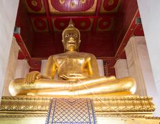 Giant gilded Buddha Buddhist temple Chang Wat Phra Ayutthaya Thailand Asia Stock Photos