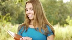 Portrait beautiful woman reading book Stock Footage