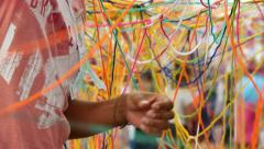 Children Enjoying with Skeins of Multicolored Wool Stock Footage