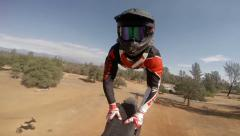 POV action camera shot of motocross rider going off jump Stock Footage