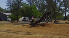 Motocross rider going off big jump, slow motion, 4K shot on RED Epic - stock footage