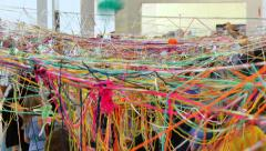 Kids Enjoying with Skeins of Multicolored Wool Stock Footage