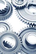 Metal cog wheels bonding together Stock Photos