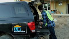 Construction workers get tools from truck, (fake company logos) Stock Footage