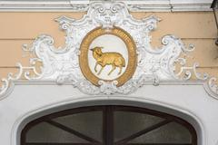 Relief over the entrance of the former Gasthaus Zum Goldenen Lamm guesthouse - stock photo
