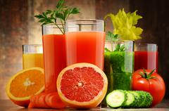 Glasses with fresh organic vegetable and fruit juices. Detox diet Stock Photos