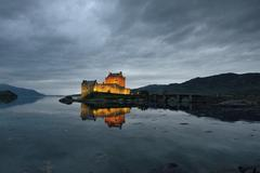 Eilean Donan Castle ancestral seat of the Scottish clan of Macrae reflection in - stock photo