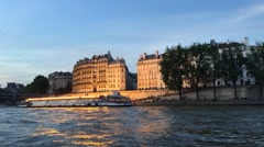 Night boat on the Seine river near Notre Dame Stock Footage