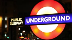 London public subway underground sign at night Stock Footage