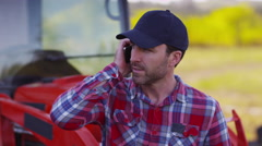 Farmer talking on cell phone - stock footage