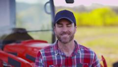 Portrait of farmer sitting on tractor Stock Footage