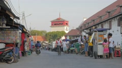 Road in Batavia with food stalls and watchtower for port,Jakarta,Java,Indonesia Stock Footage