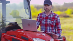 Farmer using laptop computer Stock Footage