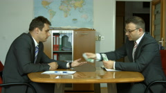 Corruption. Businessman in a suit takes a bribe. Euros Stock Footage